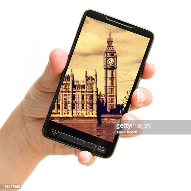 Holding a telephone with London Big Ben