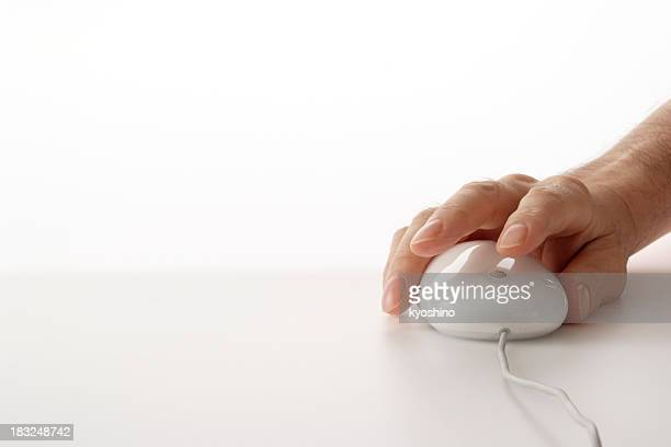 Holding a white computer mouse against white background