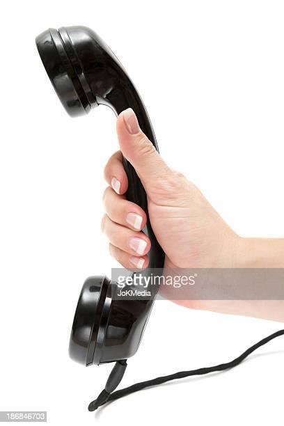 Hält eine alte Telefonhörer