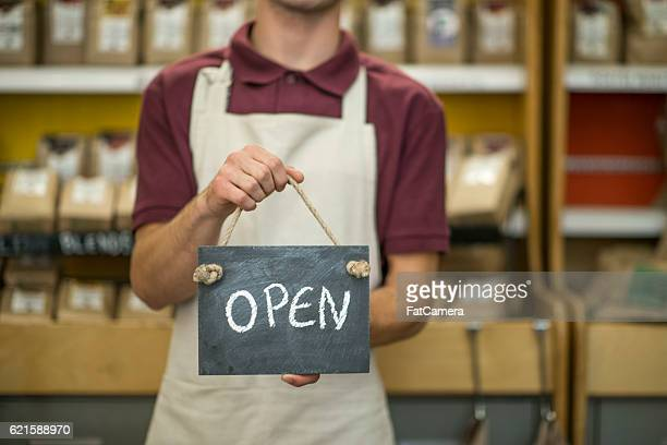 Holding an Open Sign