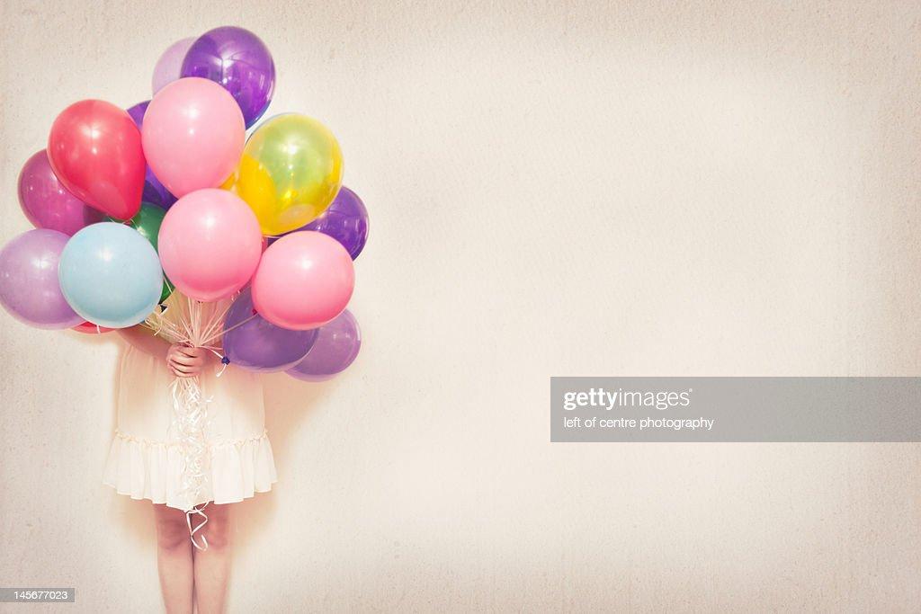 Holding balloons : Stock Photo