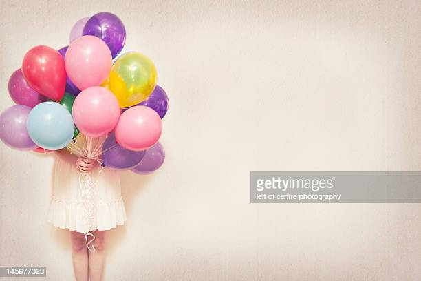 Holding balloons