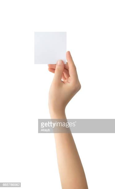 Holding blank note paper , isolated