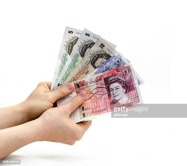 holding british banknotes - fifty pound note stock pictures, royalty-free photos & images