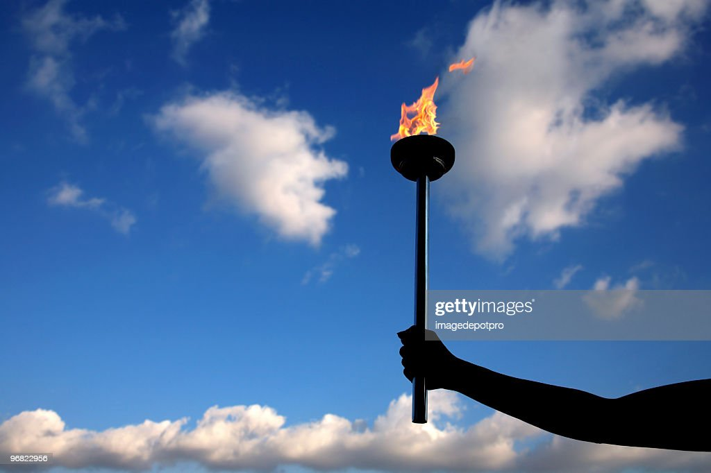 holding burning flaming torch : Stock Photo