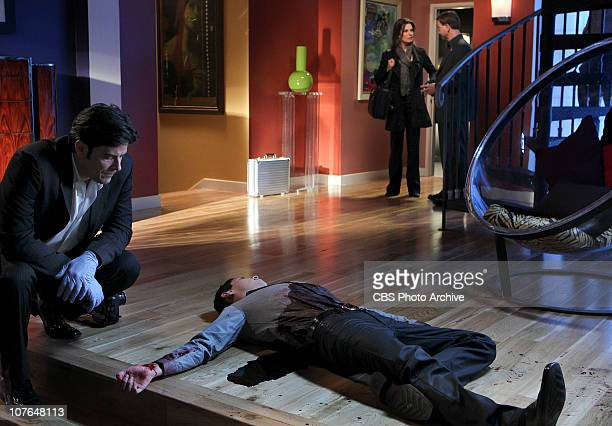 Holding Cell Hector Vargas from left Det Jo Danville and Det Mac Taylor at a crime scene where a Spanish club promoter is found dead on CSINY...