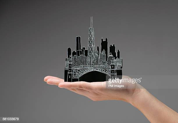 Holding Chicago in hand