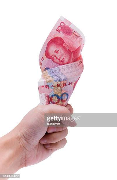 Holding Chinese Yuan Note (clipping path) isolated on white background