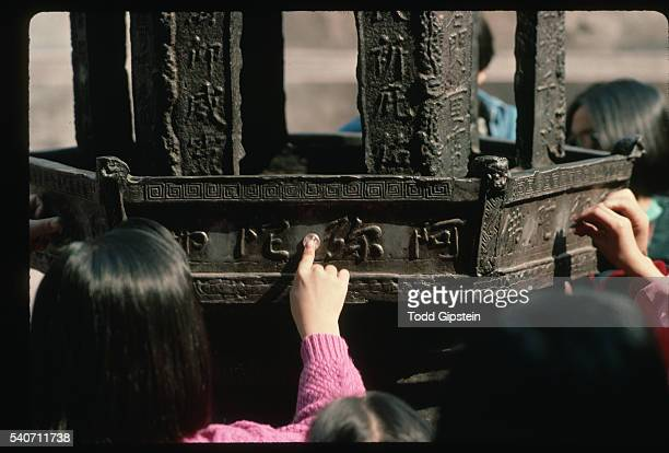 holding coins on incense burner - wuhan stock photos and pictures