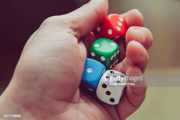 holding dice - bad luck stock pictures, royalty-free photos & images