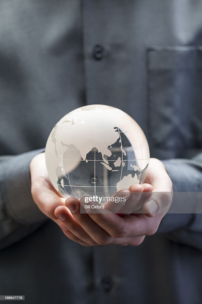 Holding globe - Asia : Stock Photo