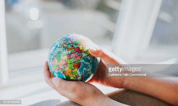 holding globe - global communications stock pictures, royalty-free photos & images