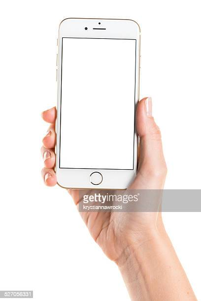 Holding gold iPhone 6 with white screen