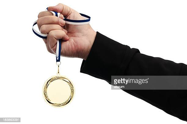 holding gold medal