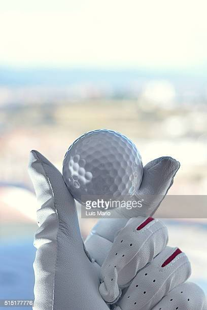 holding golf ball