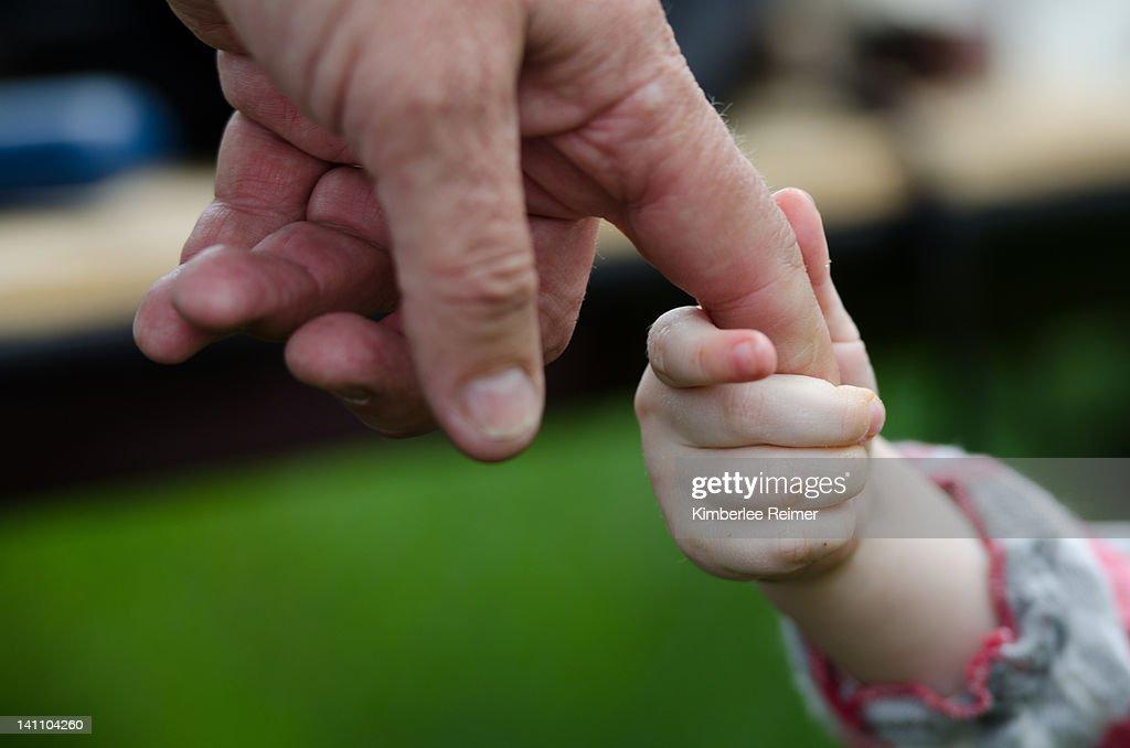 Holding grandpa hand : Stock Photo