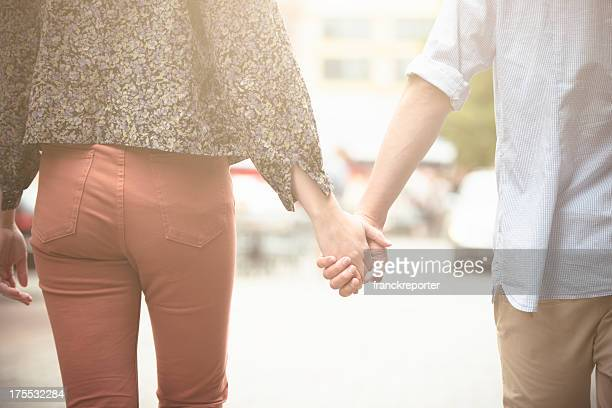 Holding hands, caucasian couple in love