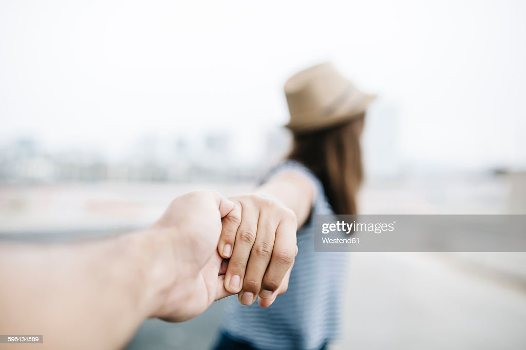 Holding hands, close-up : Stock Photo