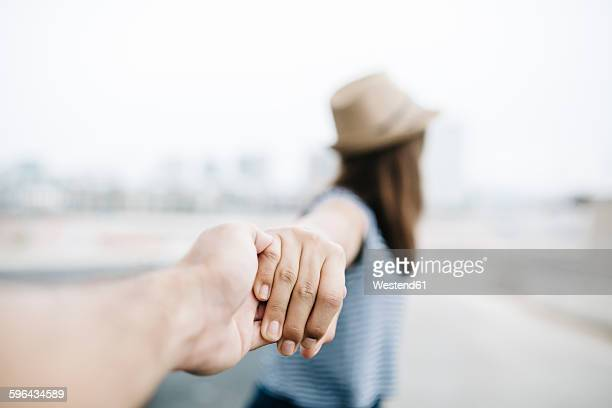 holding hands, close-up - vertrauen stock-fotos und bilder