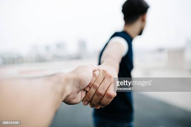 Holding hands, close-up