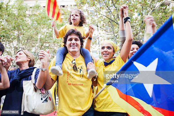 holding hands for the break of catalonia from spain - estelada stock pictures, royalty-free photos & images