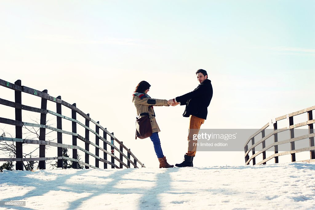 Holding hands in snow walk : Photo