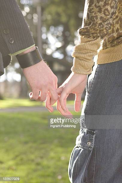 Holding Hands In The Park