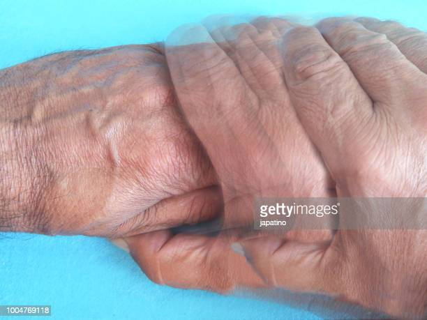 holding hands - shaking stock pictures, royalty-free photos & images