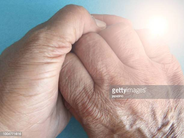 holding hands - streptomyces antibioticus stock photos and pictures