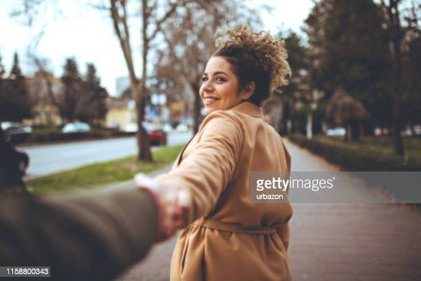 holding hands - suave stock pictures, royalty-free photos & images
