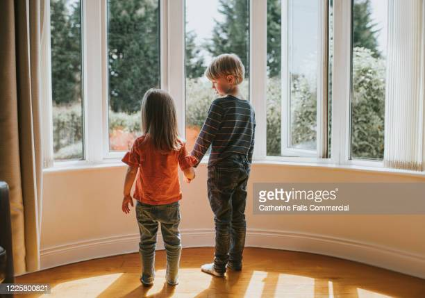 holding hands - lockdown stock pictures, royalty-free photos & images