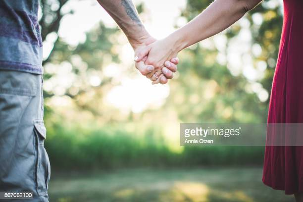 holding hands - love at first sight stock pictures, royalty-free photos & images