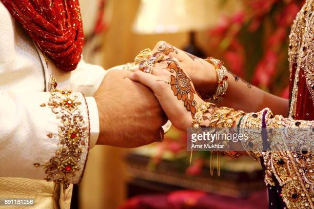 holding hands - punjab pakistan stock photos and pictures