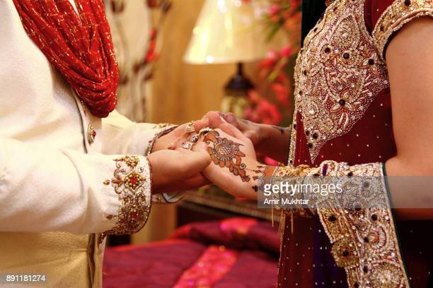 holding hands - punjab pakistan stock pictures, royalty-free photos & images