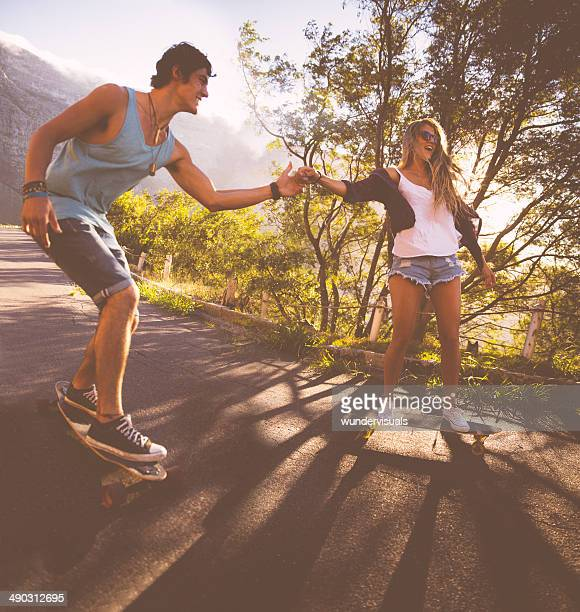 Holding hands while skateboarding