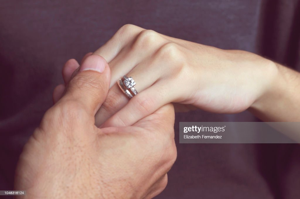 Holding Hands with engagement ring : Stock Photo