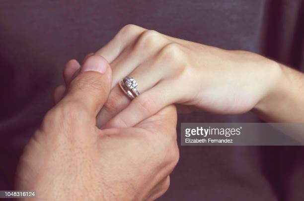 holding hands with engagement ring - anello gioiello foto e immagini stock