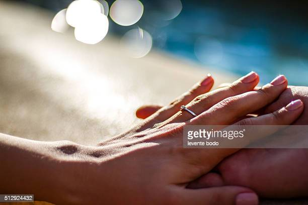 Holding Hands with wedding rings, wedding and engagement background