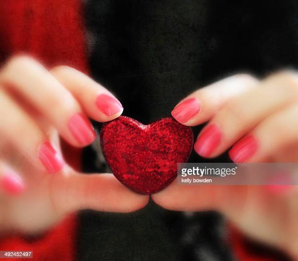 Holding heart in hands