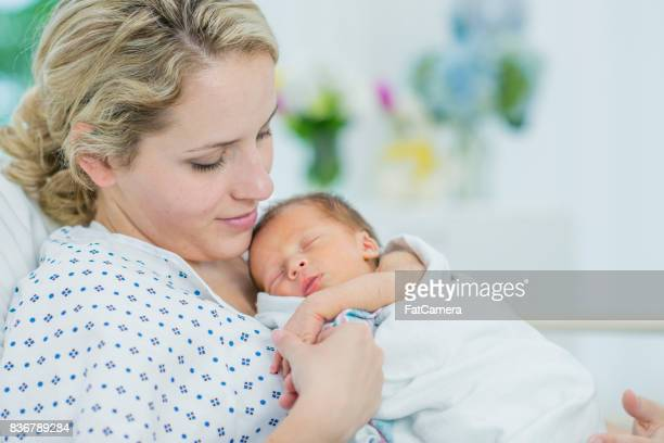 Holding Her Newborn's Hand