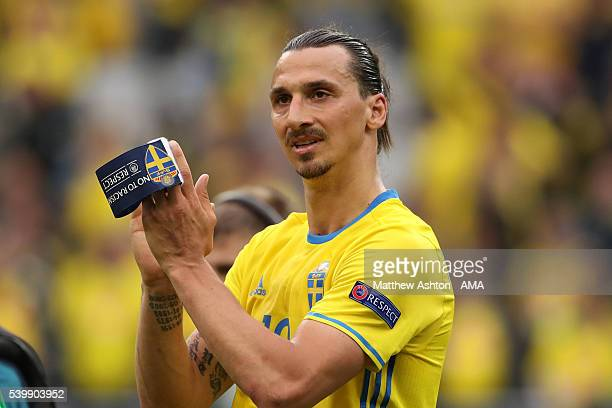 Holding his captains armband Zlatan Ibrahimovich of Sweden applauds the fans at the end of the UEFA EURO 2016 Group E match between Republic of...
