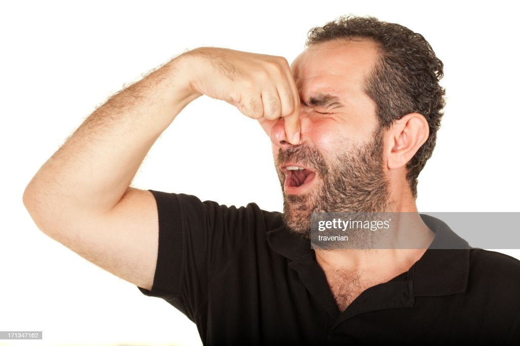 Holding his nose : Stock Photo