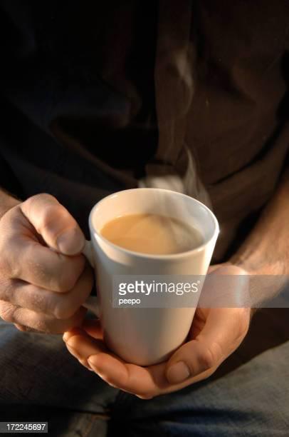 holding hot tea