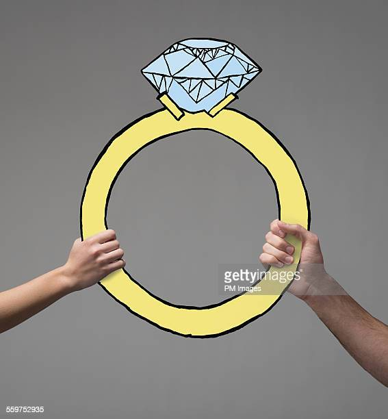 Holding illustrated engagement ring