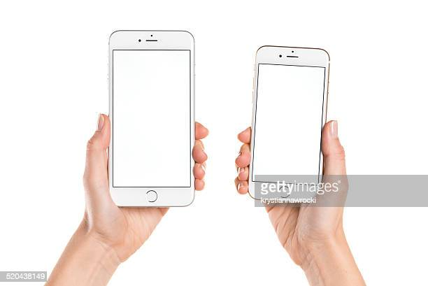 Holding iPhone 6 and iPhone 6 Plus with white screen