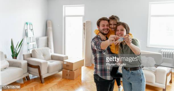 holding keys of their new home - beginnings stock pictures, royalty-free photos & images