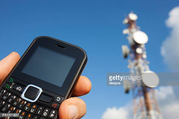Holding mobile cell phone and communication tower