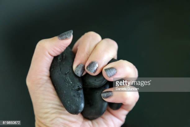 Holding onix, matching nail polish