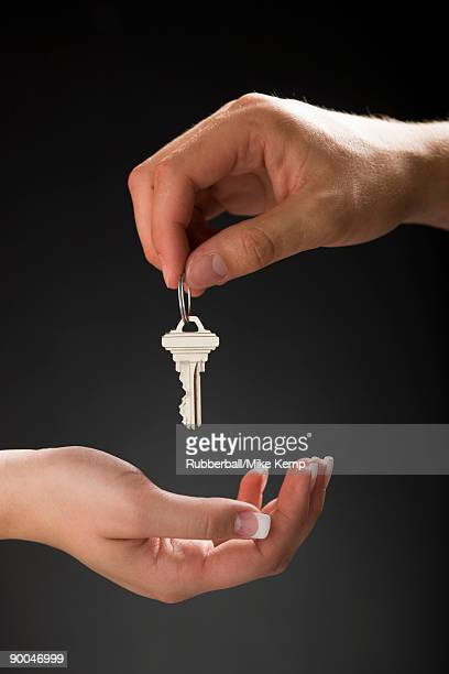holding out a house key