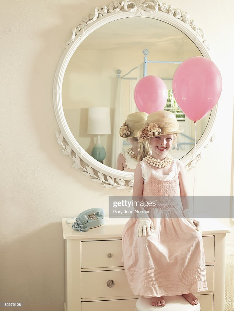 holding pink balloon young girl in fancy dress ストックフォト
